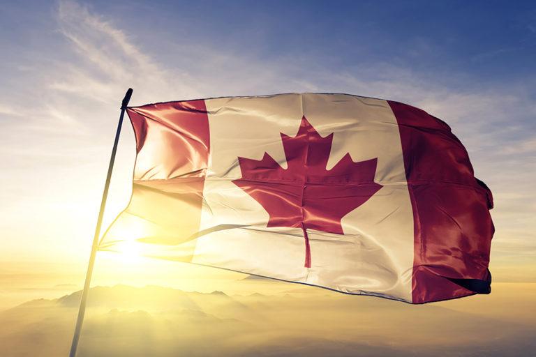 Canada Canadian flag textile cloth fabric waving on the top sunr
