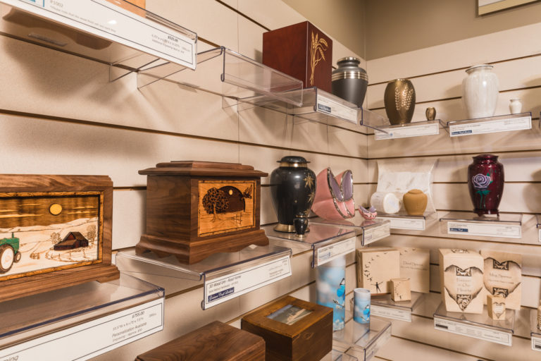 Urn Selections on site at Oliver's Funeral Home. The display of many of the urns, keepsake urns, scattering tubes, square urns, butterfly urns, that you can choose from