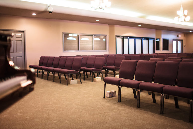 Chapel and Reception Hall on site at Oliver's Funeral Home. Rows of chairs in the reception hall.