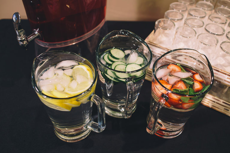 Catering on site at Oliver's Funeral Home. Water jug with lemons, water jug with cucumbers, and water jug with strawberries.