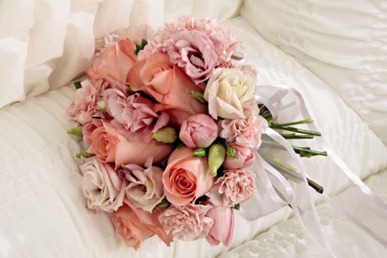 Funeral Flowers in Casket, pink roses and flowers in a bouquet