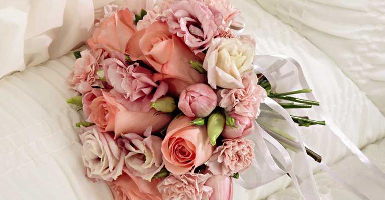 Pink funeral flowers in a casket grande prairie